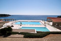 Swimming pools of luxury holiday hotel, amazing nature view landscape sea. Relax near two swimming pools with handrail. Swimming pools of luxury holiday hotel stock photo