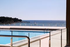 Swimming pools of luxury holiday hotel, amazing nature view landscape sea. Relax near two swimming pools with handrail. Swimming pools of luxury holiday hotel royalty free stock images