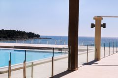 Swimming pools of luxury holiday hotel, amazing nature view landscape sea. Relax near two swimming pools with handrail. Swimming pools of luxury holiday hotel stock photography
