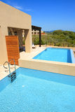 Swimming pools by luxury villas with sea view Royalty Free Stock Photography