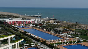 The swimming pools near beach at the luxury hotel stock video