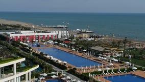 The swimming pools near beach at the luxury hotel. Antalya, Turkey stock video