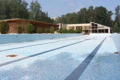 Swimming pools are soon ready. Building a brand new swimming pool with facilities Stock Photos