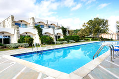 Swimming pools by villas at the luxury hotel Stock Images