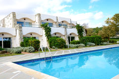 Swimming pools by villas at the luxury hotel Stock Photography
