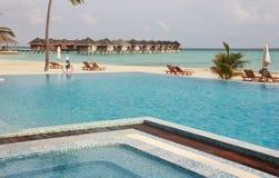 Swimming pools and water villas, Maldives. Swimming pools, white sand beach and water villas on Maafushivaru island. Ari Atoll, Maldives Stock Photos