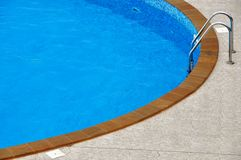 Swimming ppol. Blue swimming pool with entrance stairs Stock Image