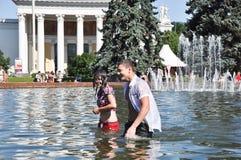 Swimming in Public Fountain Stock Photo