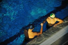 Swimming race winner stock images