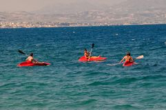 Swimming in a red boats at Loutraki beach Stock Photography