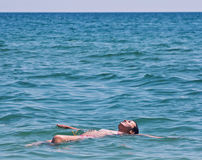 Swimming and relaxing Stock Image