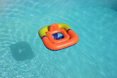 Swimming ring. A child's swimming ring floating in a pool Stock Photos