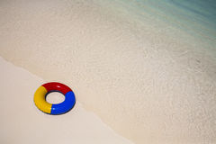 Swimming ring at the beach Stock Photos