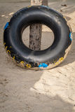 A swimming ring on beach Royalty Free Stock Image