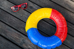 Swimming ring and sunglasses Stock Photo