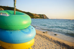 Swimming rings on the beach Stock Photography