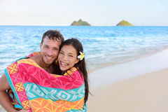 Swimming romantic couple bathing towel on beach Stock Photography