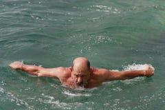 Swimming senior man Stock Photo