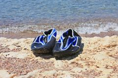 Swimming shoes on stone Royalty Free Stock Photos