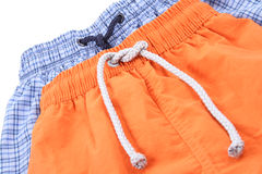 Swimming shorts. Blue and orange swimming shorts - clothing Stock Photo