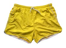 Swimming shorts - yellow. Yellow swimming shorts isolated on white with Clipping Path Royalty Free Stock Image