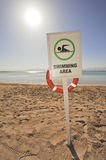 Swimming sign on a tropical beach Stock Photos