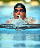 Swimming - Sport. Swimmer with cap and goggles swimming in breaststroke