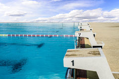 Swimming start platform with blue sky. Royalty Free Stock Images