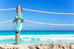 Swimming stripped bikini hang on ropes of pier Royalty Free Stock Image