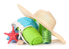 Swimming suit and beach items. Isolated on white background stock image