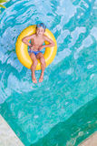 Swimming, summer vacation - child boy playing in blue wat Royalty Free Stock Photography