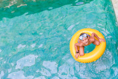 Swimming, summer vacation - child boy playing in blue wat Royalty Free Stock Photo