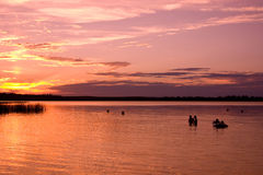 Swimming at Sunset. Some people swimming at sunset at Madge Lake in Saskatchewan, Canada royalty free stock photography