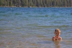 Child swimming in Tenaya Lake, Yosemite National Park stock images