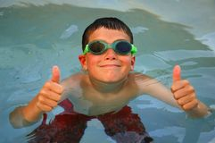 Swimming Thumbs Up. Young Boy enjoying his swim Royalty Free Stock Image