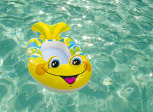 Swimming toy in a pool. Bright kid's swimming toy in the pool Stock Photos