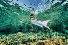 Swimming in transparent sea Royalty Free Stock Photo