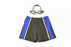 Swimming trunks. And glasses on white background Royalty Free Stock Images