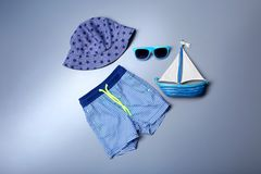 Swimming trunks with hat and sunglasses. On light background. Holiday concept Royalty Free Stock Images