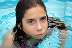 Swimming Tween With Bad Attitude Royalty Free Stock Photos
