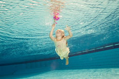 Swimming under the water girl with flower Royalty Free Stock Images