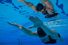 Swimming underwater Royalty Free Stock Images