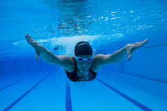 Swimming underwater Stock Photo