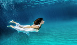 Swimming underwater Royalty Free Stock Image