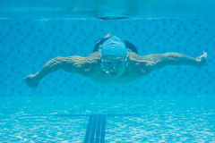 Swimming underwater. Image of a young guy swimming underwater Royalty Free Stock Photos