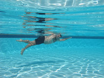 Swimming underwater photo Stock Image