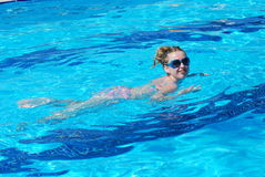 Swimming woman. In a pool - summer sport Stock Photography