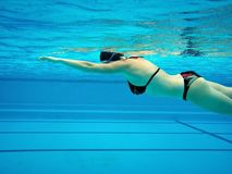 Swimming woman Stock Images