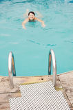 Swimming woman in an outdoor pool. (focus on foreground Royalty Free Stock Images