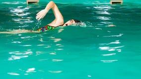Swimming woman in pool. Stock Image